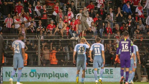 Monaco's players feel the anger of their fans after a loss to Nimes