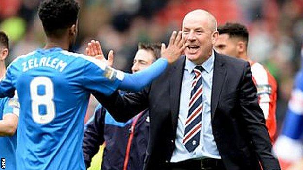 Mark Warburton celebrates Rangers' Scottish Cup semi-final win over Celtic with Gedion Zelalem