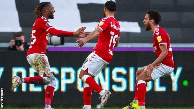 Kasey Palmer (left) celebrates after scoring his first goal since returning to Bristol City from his loan spell at Swansea
