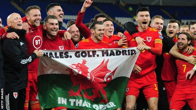 Tom KIng, third from the left, alongside Gareth Bale celebrating victory over Hungary that sealed Euro qualification