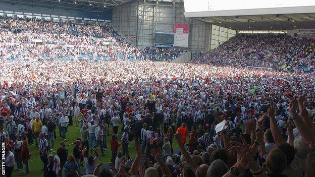 West Brom fans invaded the pitch after their 2-0 win over Portsmouth sealed their unlikely surival on the final day in 2004-05
