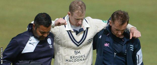 Adam Voges is helped from the field