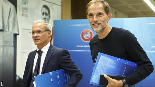 Uefa's Giorgio Marchetti and PSG boss Thomas Tuchel