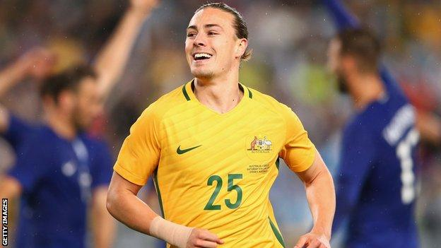 Jackson Irvine celebrates with Australia against Greece