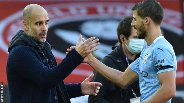 Manchester City boss Pep Guardiola and defender Ruben Dias