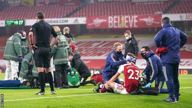 Medics tend to Raul Jimenez and David Luiz