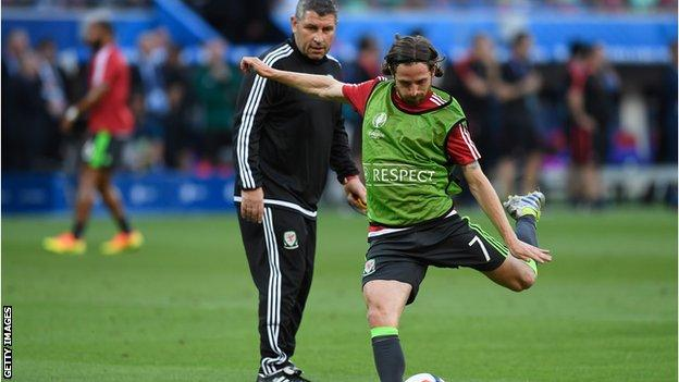 Wales assistant Osian Roberts (behind Joe Allen) is one of the candidates to succeed Chris Coleman as Wales manager