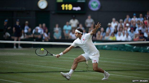 Roger Federer hitting a volley at Wimbledon