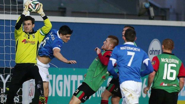 Glentoran keeper Elliott Morris makes the save as Linfield attack