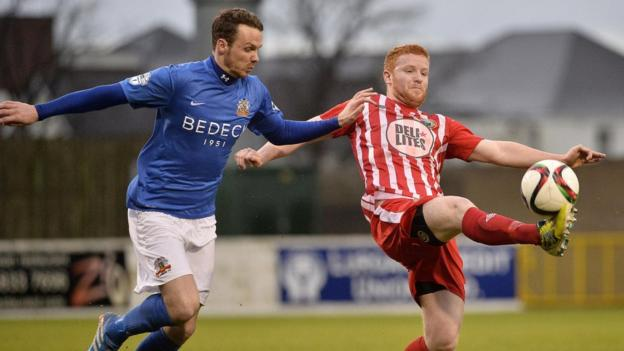 Glenavon's Andy Hall and Stephen Moan of Warrenpoint contend for possession at Mourneview Park