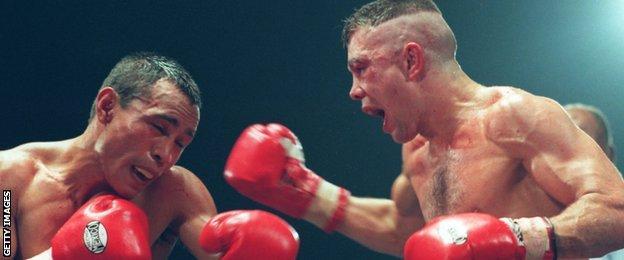 Robbie Regan fighting Alberto Jimenez