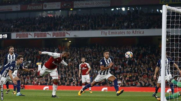 Alexandre Lacazette heads in against West Brom