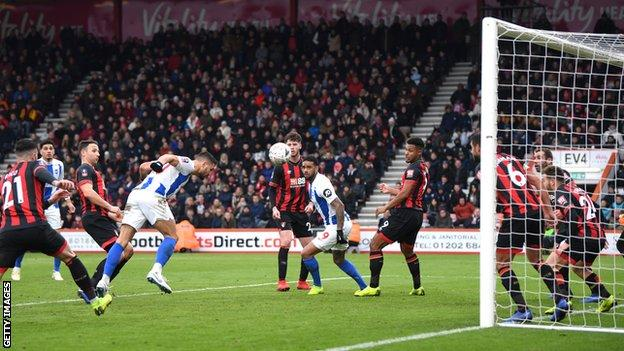 Brighton striker Florin Andone heads in his side's third goal in victory over Bournemouth