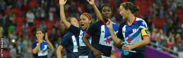 Great Britain defender Casey Stoney (right) celebrates with teammates during the London 2012 Olympic Games
