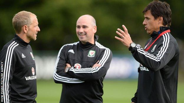 Paul Trollope and Chris Coleman during a Wales training session