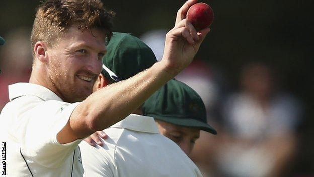 Australia's Jackson Bird raises the ball after finishing with five wickets against New Zealand