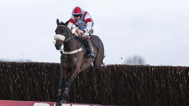 Aidan Coleman riding Saint Calvados clear the last to win The Betfred Mobile Novices' Limited Handicap Chase at Newbury