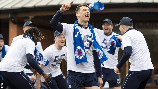 Ryan Jack leads the celebrations as the Rangers players celebrate at their training ground