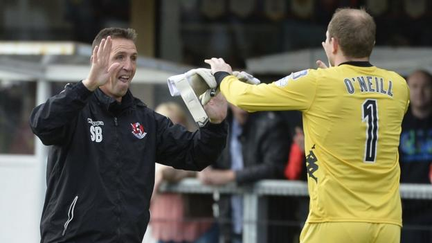 Crusaders manager Stephen Baxter celebrates with goalkeeper Sean O'Neill after the final whistle
