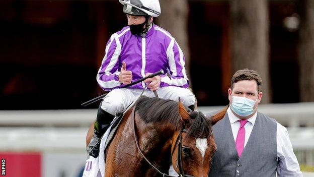Seamie Heffernan gives the thumps up after Magical's second straight win the Irish Champion Stakes