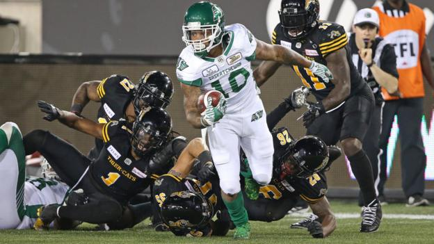 CFA - HAMILTON, ON - JULY 19: Tre Mason #10 of the Saskatchewan Roughriders eludes a series of tackles against the Hamilton Tiger-Cats in a CFL game at Tim Hortons Field on July 19, 2018 in Hamilton, Ontario,Canada. The Roughriders defeated the Tiger-Cats 31-20. (Photo by Claus Andersen/Getty Images)