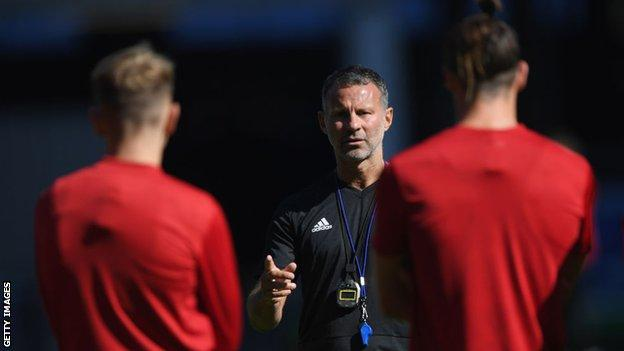 Wales manager Ryan Giggs talks to his players as he prepares for his first competitive game in charge