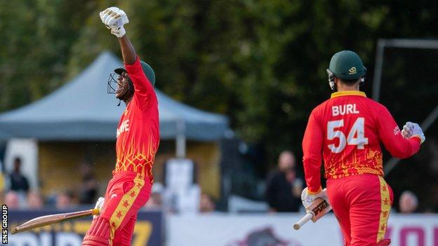 Milton Shumba celebrates Zimbabwe's win during a T20 international between Scotland and Zimbabwe at the Grange
