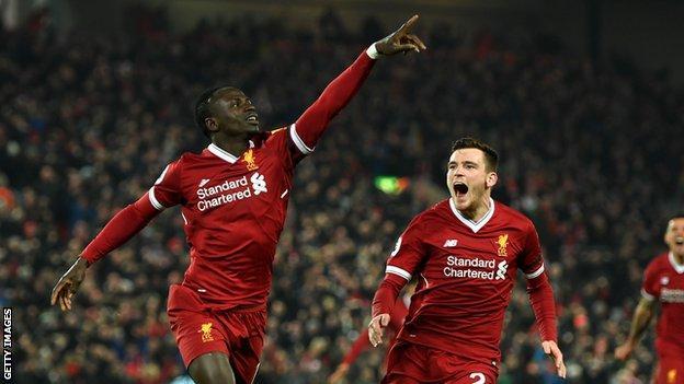 Sadio Mane celebrates with Andrew Robertson