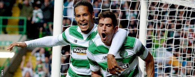 Celtic's Nir Bitton (right) celebrates scoring against Malmo
