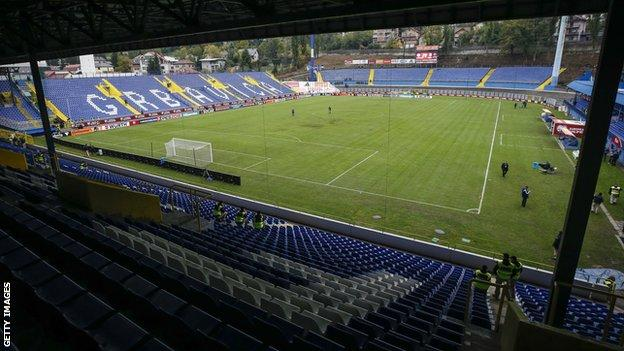 The game will be played behind closed doors at the Grbavica Stadium in Sarajevo