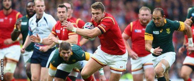 Dan Biggar makes a break for Wales against South Africa in the 2015 World Cup
