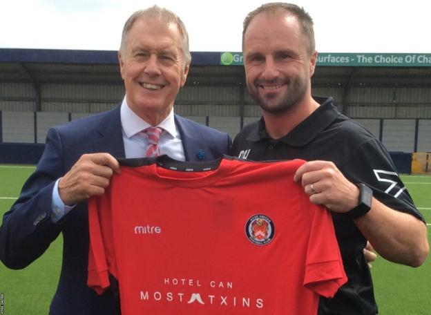 England World Cup hero Sir Geoff Hurst is presented with a Hyde United shirt by Tigers boss Darren Kelly
