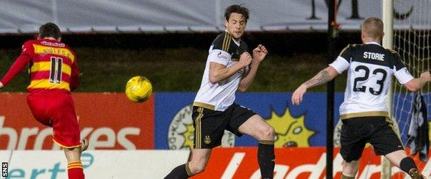 Partick Thistle's Steven Lawless sends his drive into the Aberdeen net
