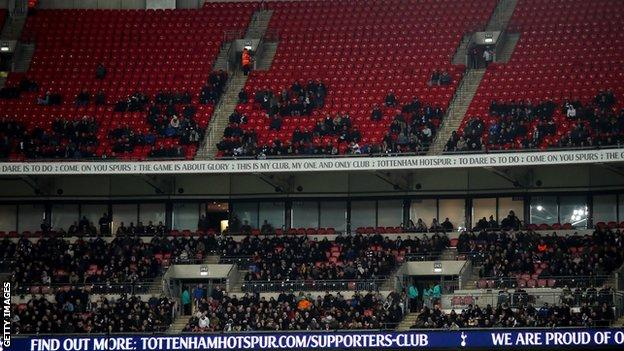 Empty seats in the upper tier of Wembley Stadium during Spurs' match against Man City