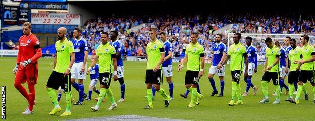 Brighton & Hove Albion and Ipswich Town emerge onto the pitch