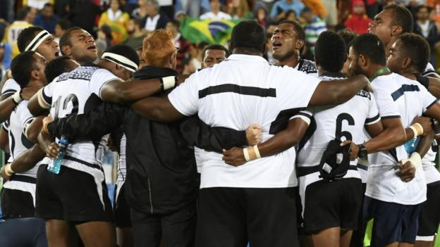 Fiji players sing after winning the rugby sevens