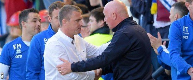 Kilmarnock manager Lee Clark is congratulated by Peter Houston