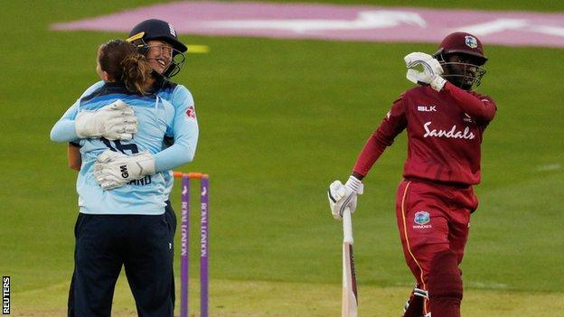 England's Kate Cross and Sarah Taylor celebrate the wicket of West Indies' Kycia Knight