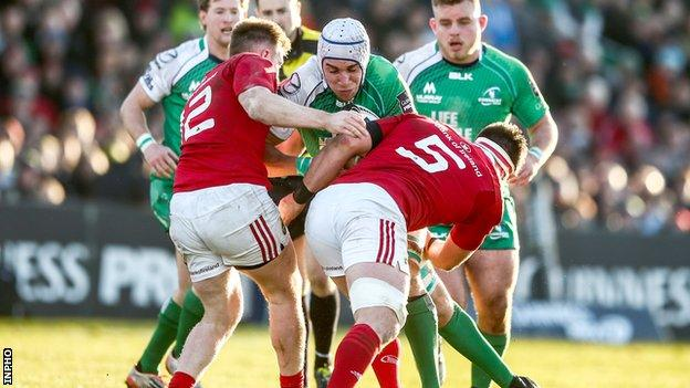 Rory Scannell and Billy Holland combine to tackle Ultan Dillane