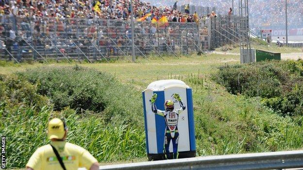 Valentino Rossi celebrating a race victory in a Portaloo