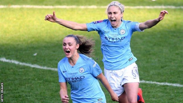 Manchester City women players Georgia Stanway (left) and Steph Houghton (right) celebrate winning the 2019 League Cup final