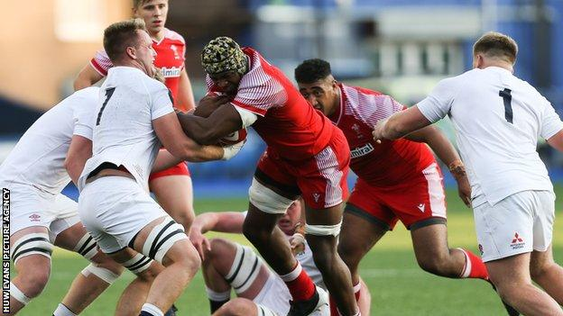 Christ Tshiunza in action for Wales Under-20s against England in the 2021 Six Nations