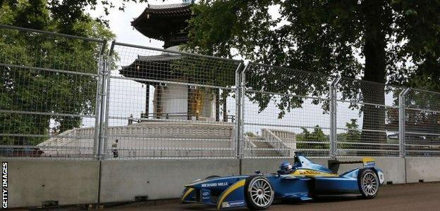 French driver Nicolas Prost drives past the peace pagoda at Battersea Park