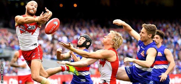Jarrad McVeigh of the Swans attempts to mark