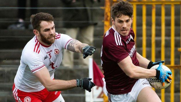 Tyrone full-back Ronan McNamee attempts to keep pace with Galway's star forward Shane Walsh