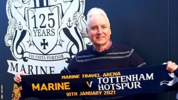 Chairman of non-league club Marine Paul Leary with a half-and-half scarf before their FA Cup third round tie with Tottenham Hotspur