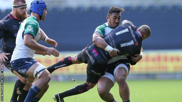 Ospreys wing Eli Walker is tackled by Bundee Aki of Connacht