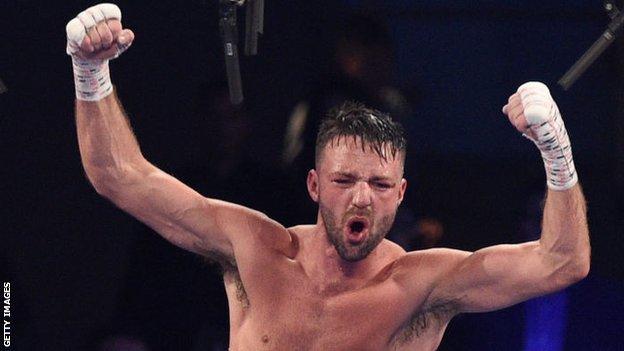 Josh Taylor celebrates after beating Jose Ramirez