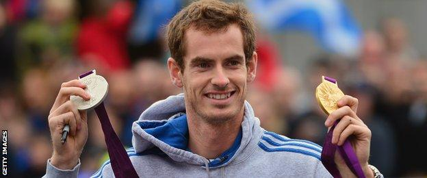 Murray shows off his singles gold and mixed doubles silver on a visit to his hometown of Dunblane