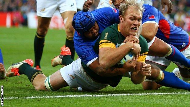 Schalk Burger of South Africa goes over to score his teams third try during the 2015 Rugby World Cup Pool B match between South Africa and Samoa